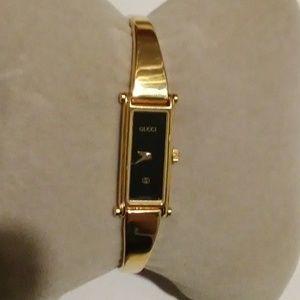 Gucci Vintage Rectangular Gold Bracelet Watch